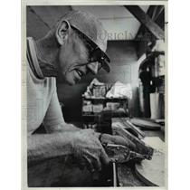 1973 Press Photo Bill Johnson works on airplane part at workbench - orb00211