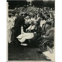 1927 Press Photo Aviator Charles A Lindberg greets handicapped veterans