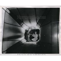 1954 Press Photo British Aviation Students adjust a model plane Wind Tunnel