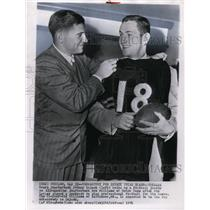 1951 Press Photo Bears Johnny Lujack Holds Jersey for Newly Signed Bob Williams