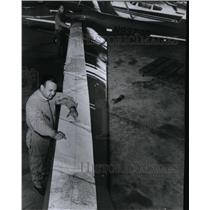1967 Press Photo James R Bede follows chart of course for a plane's wings