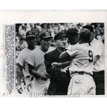 1966 Press Photo Mets manger is restrained by three umpires during fight at game