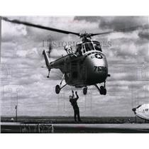 1963 Press Photo Air Force H-19 Helicopter rescues downed airman demonstration