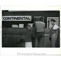 1993 Press Photo Sharon Glove at Continental's ticket counter at Spokane Int'l