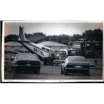 1993 Press Photo A light airplane gets checked out by firefighters - mja02596