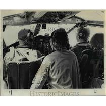 1963 Press Photo Take off tension eases when twin engined bird levels 11,000 ft.