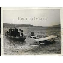 1927 Press Photo Plane Being Towed In The Port In San Francisco Bay - ney09047