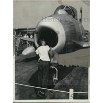 1949 Press Photo Boy looks at F-96 plane at National Air Fair at O'Hare Field