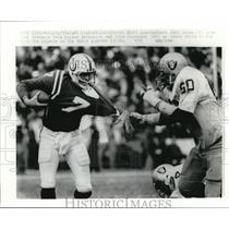 1977 Press Photo Colts Bert Jones vs Raiders Otis Sistrunk in AFC playoffs