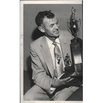 1957 Press Photo Sid Wheeler Presents Trophy to Spokane Flyer Goalie John Sofiak