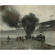 1930 Press Photo Auto racing car crash as car goes up in smoke - net15890