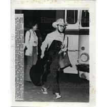 1974 Press Photo Daniel Birch disembarks from an airport at a Tunis Hotel