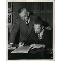 1947 Press Photo Raymond V Roberts signs as Lions athletic director - net02216