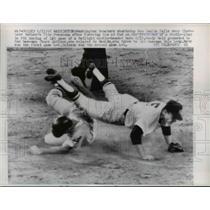1962 Press Photo Senators Ken Hamlin falls over Indian Tito Francona after slide