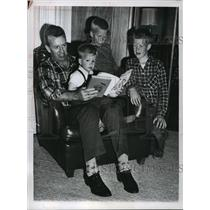 1961 Press Photo Joe Walker pilots his three sons through a reading session
