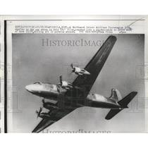 1961 Press Photo Northwest Orient Airlines 4-Engine DC-4 Airplane - ney19342