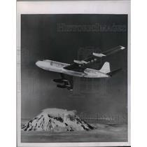 1955 Press Photo Boeing 707 Jet Transport Plane over Mt. Rainer, Washington