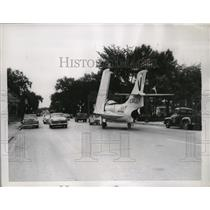 1956 Press Photo Navy Jet Fighter Plane Towed in Evanston, Illinois Traffic
