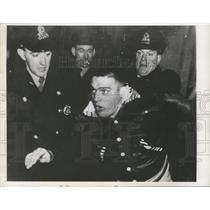 1955 Press Photo police contain rowdy hockey fan in Montreal, Detroit won game