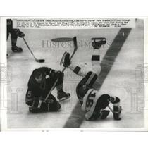 1971 Press Photo North Stars Jude Dreuin knocked down by Blues Bob Flager