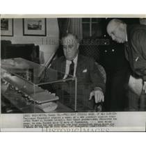 1943 Wire Photo Pres. Roosevelt studies a model of new carrier presented to him