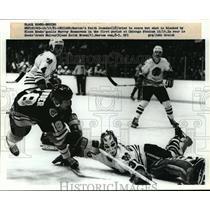 1981 Press Photo Bruins Keith Crowder vs Black Hawks Murray Bannerman Grant Mulv