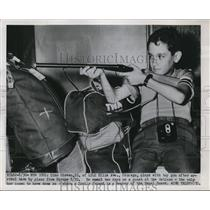 1951 Press Photo Dino Giovan of Chicago plays after arriving from Europe