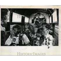 1973 Press Photo Skydivers sit back in belly of plane waiting to parachute