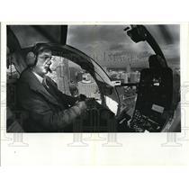 1983 Press Photo Greg Nutt of KATU over downtown Portland - oro01953