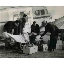 1954 Press Photo Lee Flink, Harvey Brandeau, Kooser, Fred Edens-Mercy Flight Inc