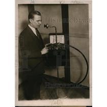 1923 Press Photo Inventor Bernas Johnson Shown with Transmitting Apparatus