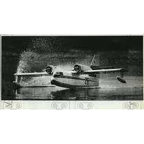 1982 Press Photo Scale model airplane of Canadair water bomber takes off