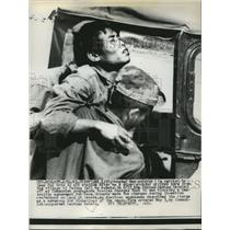 1961 Press Photo Soldier is Carried to Jeep for Trip to Aid Station - ney25196