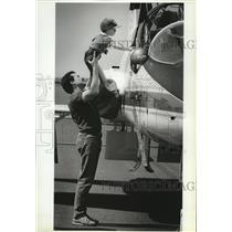 1987 Press Photo Dave Goicoechea & son John Check out NASA T38 trainer aircraft.