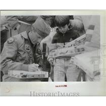 1990 Press Photo Major Blake Bourland signs autographs at Fairchild Open House
