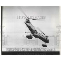 1955 Press Photo Navy H-21 Helicopter Tested As Aerial Minesweeper - ney26214