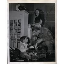 1945 Press Photo Frank Filchock of WA Redskins Helps son Johnny Fix Tricycle