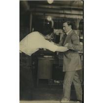 1921 Press Photo Gentleman Jack O'Brien boxer/ actor showing a man a move