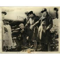1936 Press Photo Harry Richman & Dick Merrill examining damage to their plane