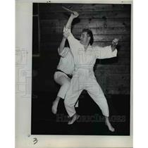 1961 Press Photo Bob Dewar with Mike Foster battle for survival - orb19589