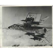 1958 Press Photo U.S Navy Cutlass Plane loaded with Sparrow Air Missle