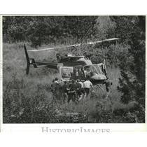 1990 Press Photo Lifebird Rescue team carries Earl Sylvester to the helicopter
