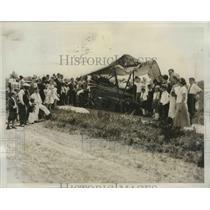 1935 Press Photo Student Pilot & Don Hepburn Removed to Hospital After Crash