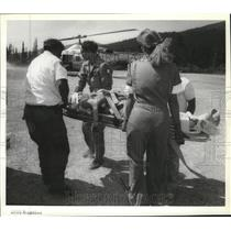 1992 Press Photo Medical team load a woman to Deaconess Lifebird Helicopter
