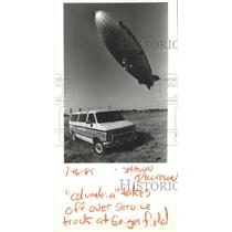 "1985 Press Photo ""Columbia"" takes off over Service truck at Geiger Field"