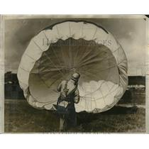 1927 Press Photo M.L. Harrison of U.S. Navy Testing Parachute at North Island