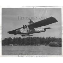 1958 Press Photo Test Pilot Dick Ulm Flies Over Wingfoot Lake During Planes Test