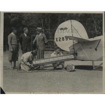 1930 Press Photo Airplane Parachute Metal Tube - neo18151