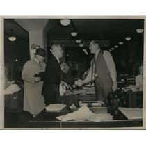 1936 Press Photo H.R. Ekins shakes hands with Lee B. Wood after flight