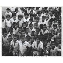 Press Photo Smiling faces of many children of Thailand - abnz01765